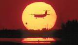 Landing at sunset aviation stock photo #SS9932L