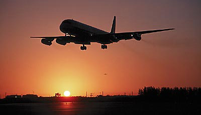 DC8 landing sunset aviation stock photo #SS9903