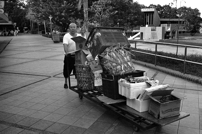 Old Man Clearing Rubbish
