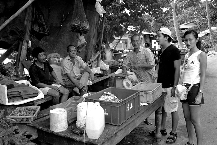 Tourists Buying Crabs