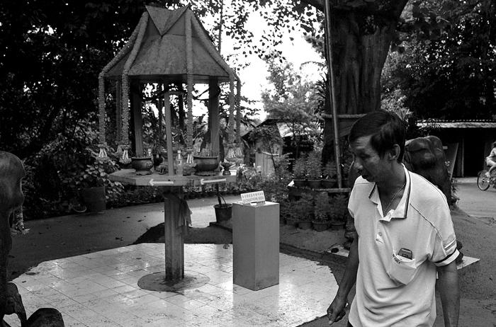 Villager at Thai Buddhist Shrine