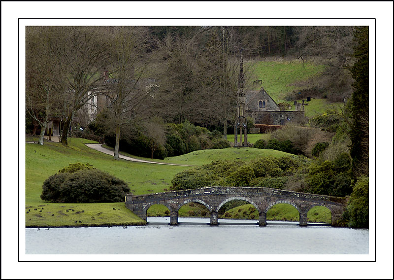 Turf bridge and monument ~ Stourhead