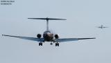 Midwest Expess DC9 on short final approach aviation stock photo
