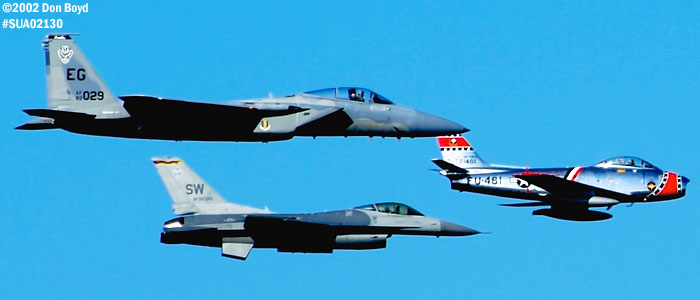 Heritage Flight of Ed Shipleys F-86 Sabre leading USAF F-15C and F-16C military aviation air show stock photo