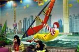Ronald McDonald windsurfing the Huangpu River, Shanghai