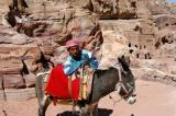 Locals offer their donkeys to take tourists up to the High Place of Sacrafice