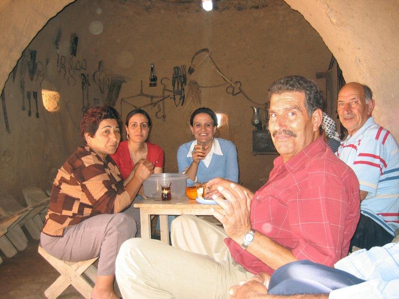 Visiting-family sharing dinner inside