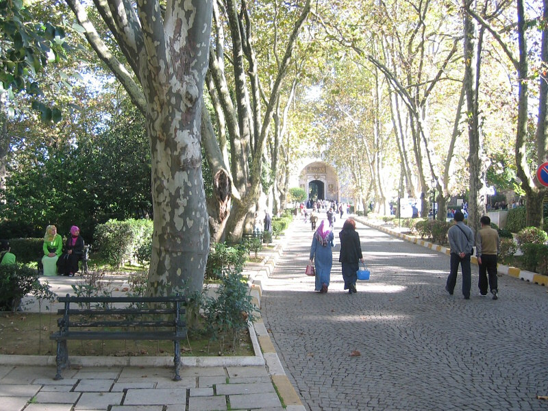 Walking toward Topkapi Palace<br>(benches on left hold interested onlookers).