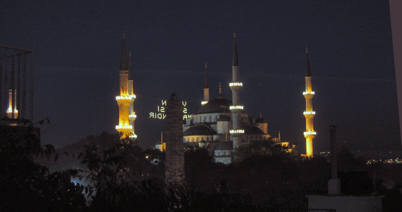 Blue Mosque at night from the hotel rooftop, Column of Constantine in front.