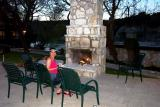 Diane enjoying the outside fireplace