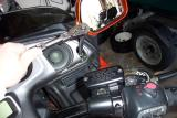 Now remove the instrument panel cover. Take out the bolts and push rivets under the speaker grills