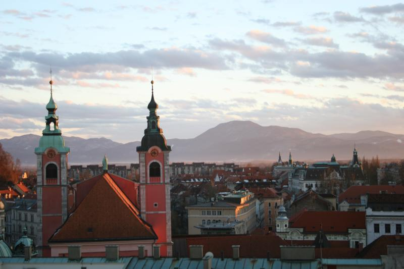 sunset over Ljubljana with mountains in the background