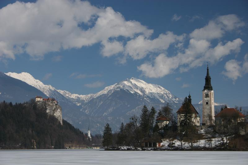 Lake Bled with Bled Castle on left Parish Church of St Martin in centre and Bled Island on right