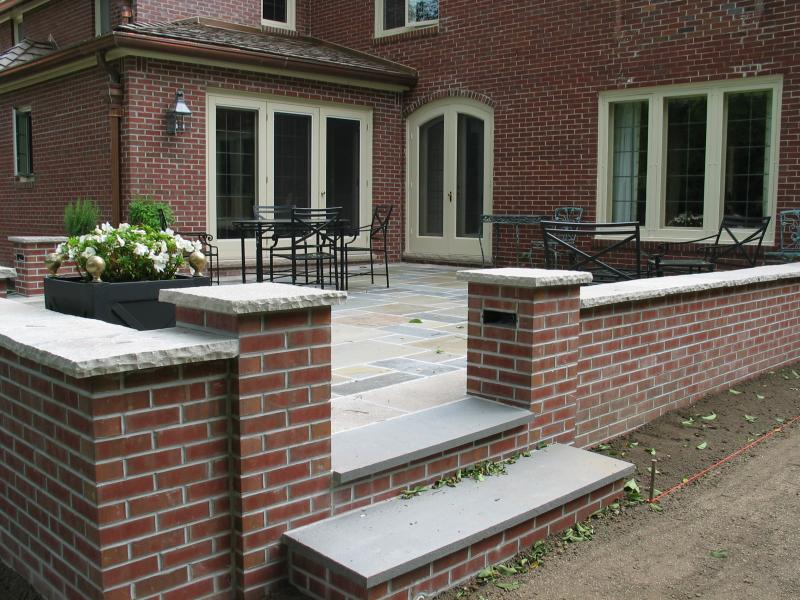 Superbe Brick Wall To Match The House And Edan Stone Cap Frameing Bluestone Patio