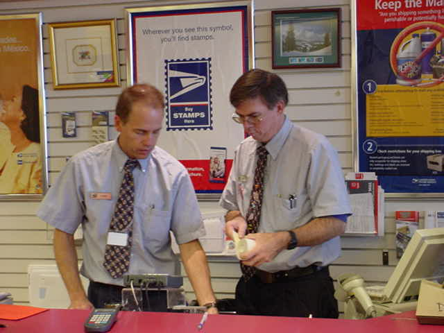 co-worker and Dave <br> working together USPS