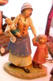 A mom brings her kids to the see the baby Jesus.