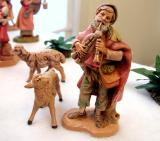 One of the shepherds (added in '01) plays his flute for the family and their guests