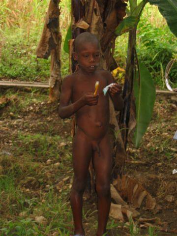 local Hatian boy brushing his teeth