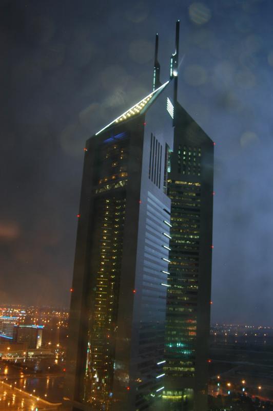 Emirates Towers illuminated by lightning