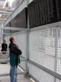 Dan views the list of names at Ground Zero