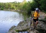 A cyclist arrives at the end of one of the towpath's  rocky sections
