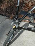 Note the two spring arbors with the conical, chromed covers pointing rearward, and mounted left and right of the steering tube's head badge.  These allow the praying mantis type handlebars to spring-load to the outside of the bike in order to damp shock transmission originating from the front axle. (This is, at first, most disconcerting to the rider who is unaccustomed to this bicycle).  I can best describe the handling as being something akin to holding the reins of a horse...that is to say, the rider must hold them firmly and up, off of the neck,  neither pulling too hard nor allowing them to slacken.