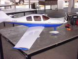 model airplane blue and white in color with a 2 cycle motor