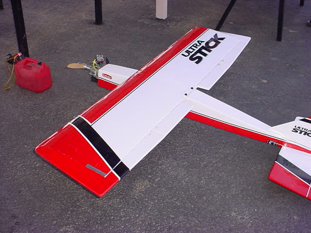 a flying balsa stick airplane with 2 cycle motor