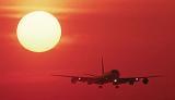 DC8 landing sunset aviation stock photo #SS9934L