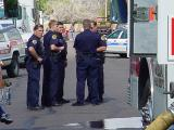 75. 5 policeman 5 firetrucks and police car