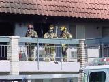 76. fireman in complete gear on fire site