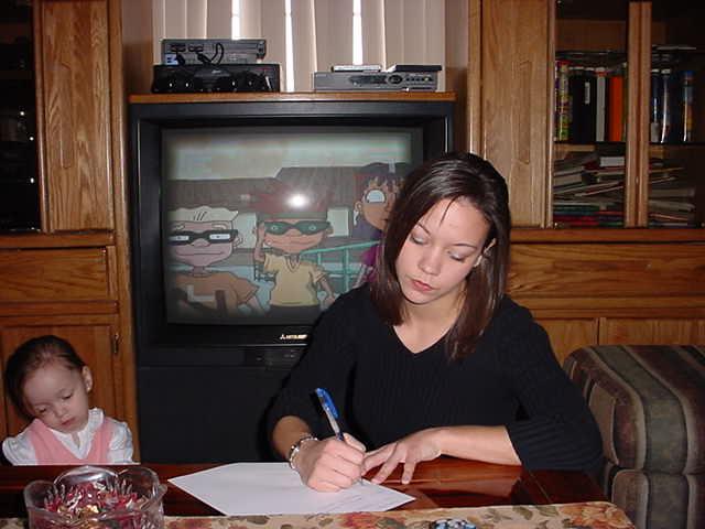 Tarina writing her address and e-mail