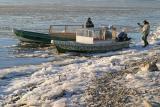 Taxis waiting at shoreline at Moosonee