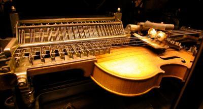 100 year old violin playing machine.