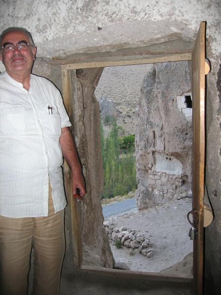Aykut at the cave church door