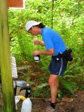 Tony refilling bottles at the turnaround