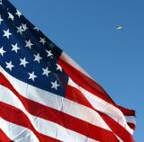 Flag with flying person shaped kite.jpg