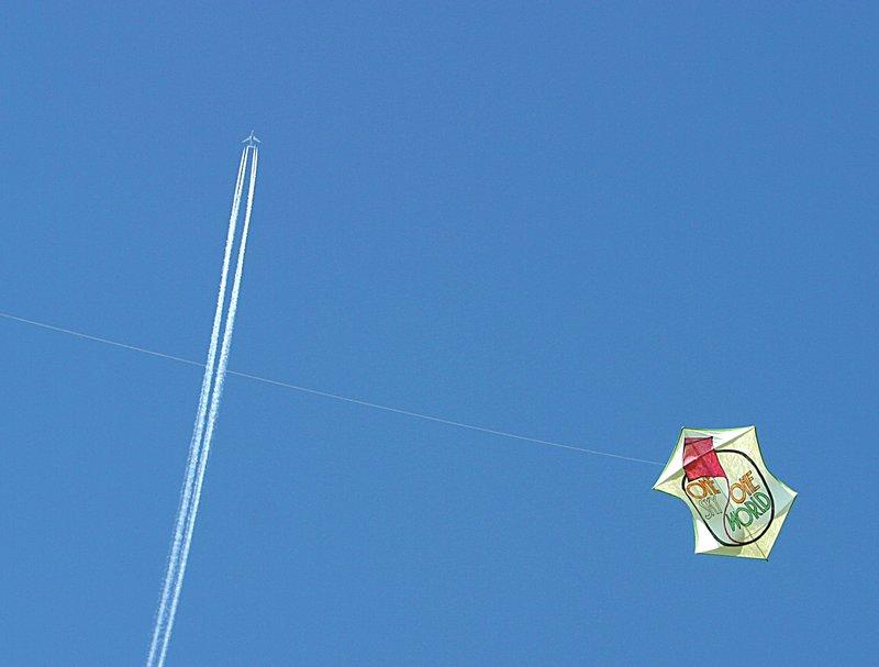 plane trail and kite.jpg