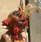 Aborigine in headress busking on street