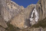 yosemite falls later in the morning, ice is falling with a boom heard across the valley