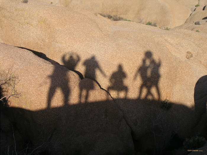Shadowy Figures At Sunset