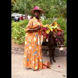 Buxom man with donkey