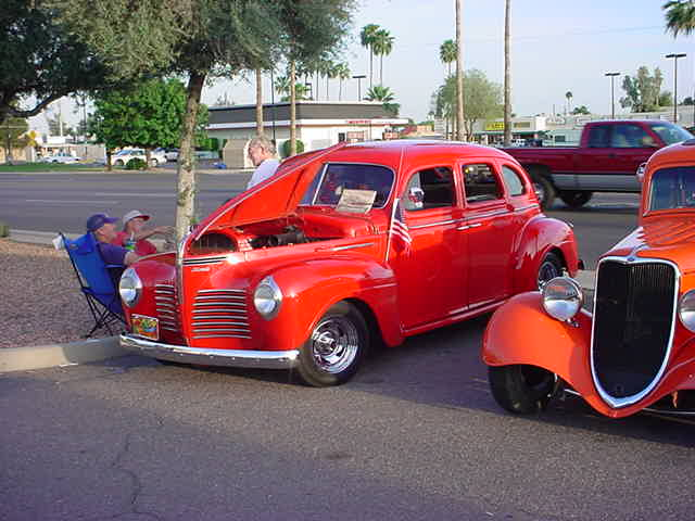 red 1940 P-10<br>Plymouth + Ford