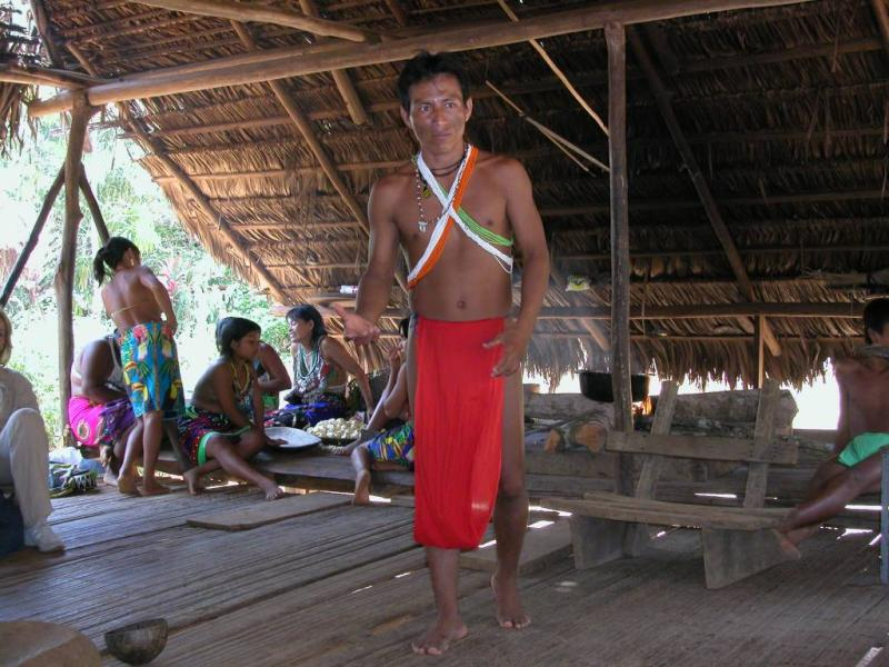 One of the leaders of the tribe explains how things work in their community; in the school kids are tought also english.