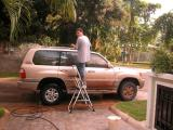 Danilo cleaning the car once we got home