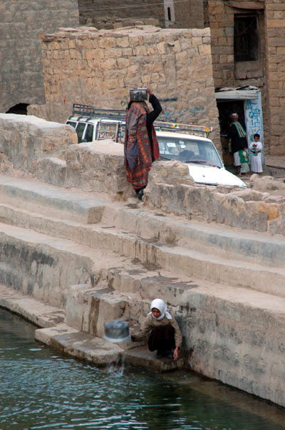 Girl fetching a pail of water, Hababa