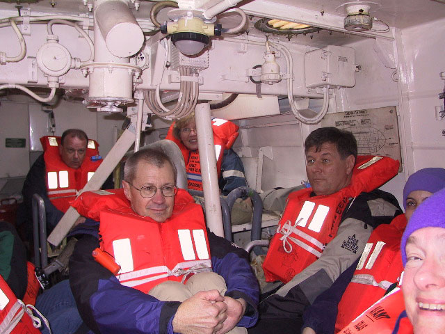 Mikes picture of Bob, Dave, Gail, Tom, Shonu & Linda enjoying our lifeboat drill -- where will the other 18 fit?