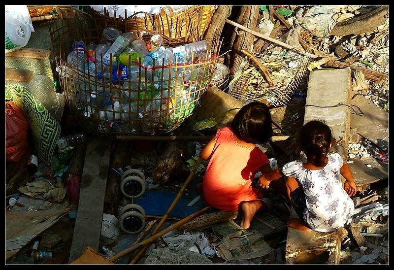 Kids playing in a garbage dump