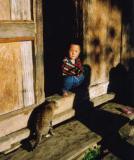 boy and cat in doorway.jpg