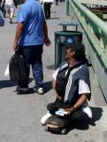 Beggar On Skateboard